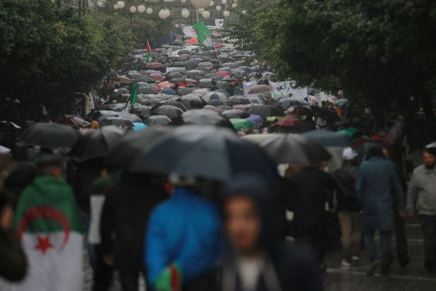 Algerian demonstrators take to the streets in the capital Algiers to protest against the government and...