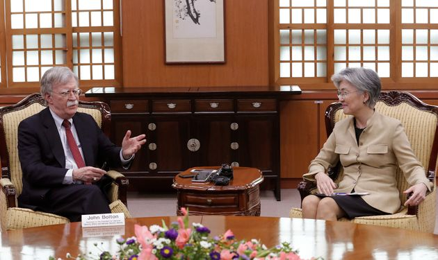 U.S. National Security Advisor John Bolton, left, talks with South Korean Foreign Minister Kang Kyung-wha...