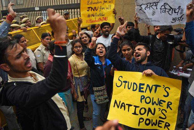 ABVP Students from JNU hold placards and shout slogans during a protest against the Hostel fee hike,...