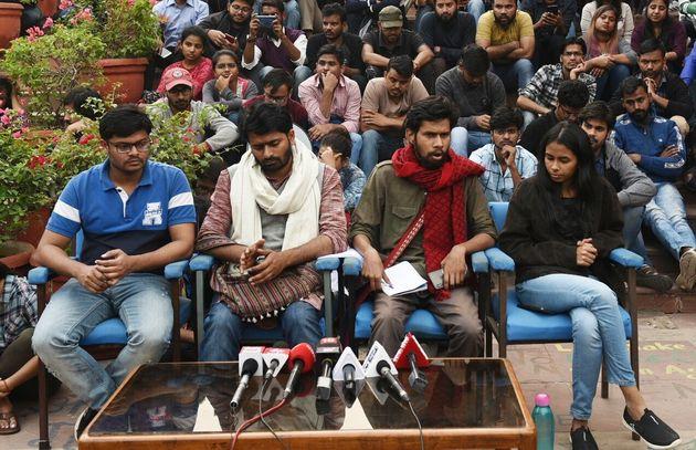 Jawaharlal Nehru University Student Union (JNUSU) Vice President Saket Moon (2R), JNUSU President Aisi...