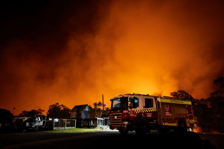 Flames illuminate the sky over a property on Putty road on November 15, 2019 in Colo Heights, Australia.