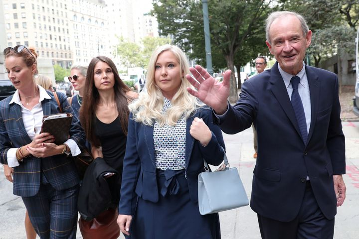 Virginia Giuffre arrives with her lawyer for hearing in the criminal case against Jeffrey Epstein at Federal Court in New York, U.S., Aug. 27, 2019.