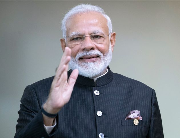 India's Prime Minister Narendra Modi greets the media prior to a meeting of leaders of the BRICS emerging...