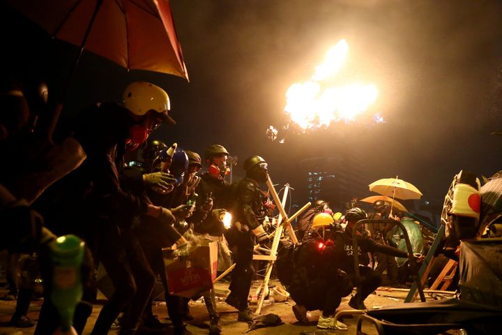 Anti-government protesters prepare molotov cocktails during clashes with police, outside Hong Kong Polytechnic University (Po