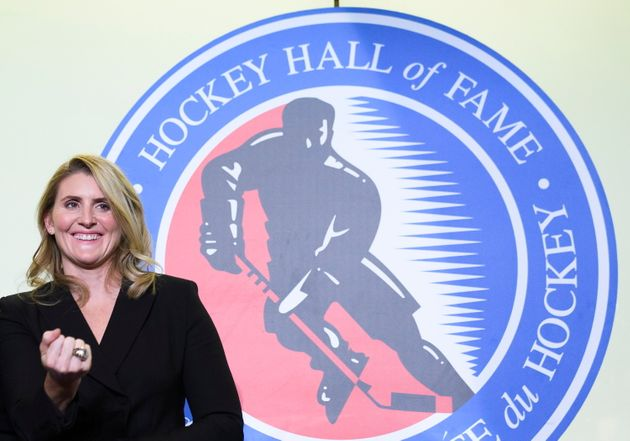 Hockey Hall of Fame inductee Hayley Wickenheiser shows off her ring on stage in Toronto on