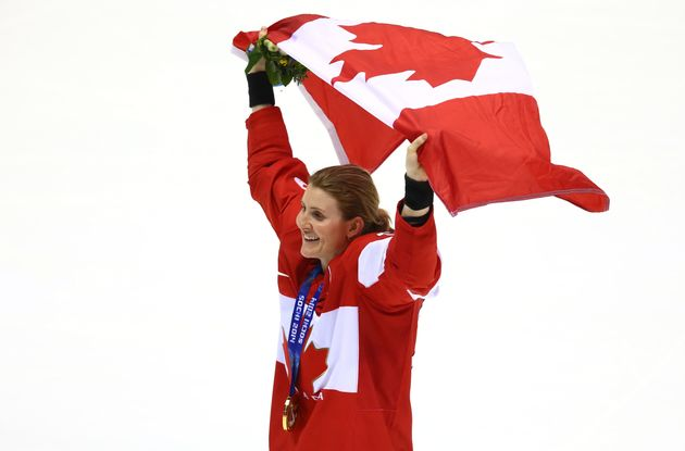 Hayley Wickenheiser celebrates after defeating the United States 3-2 in overtime on day 13 of the Sochi...