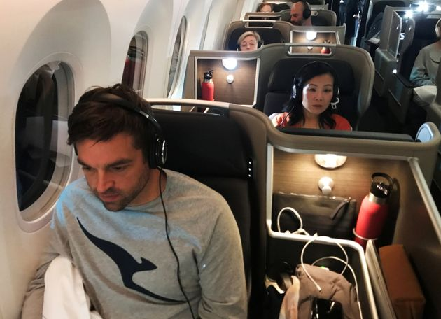 Passengers are seen on board Qantas flight QF7879, flying direct from London to Sydney, November 14,...