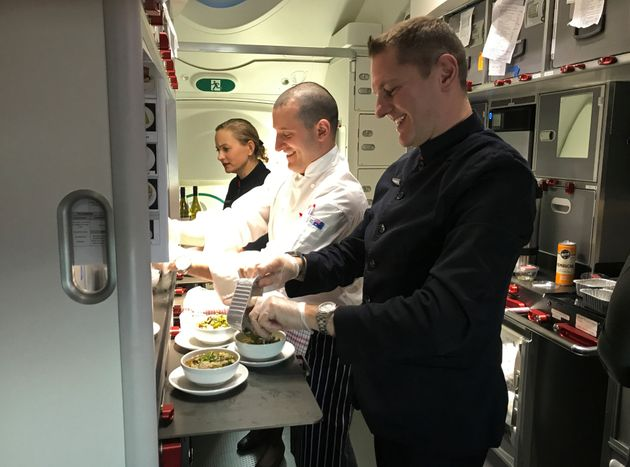 Crew members prepare food on board Qantas flight QF7879, flying direct from London to Sydney, November...