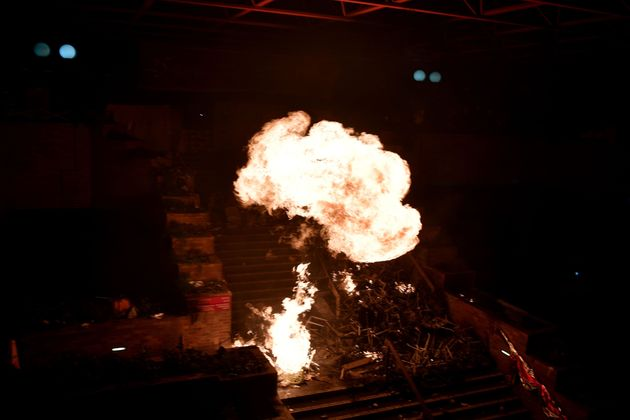Flames rise from a large fire started by anti-government protesters in a staircase at the main entrance...