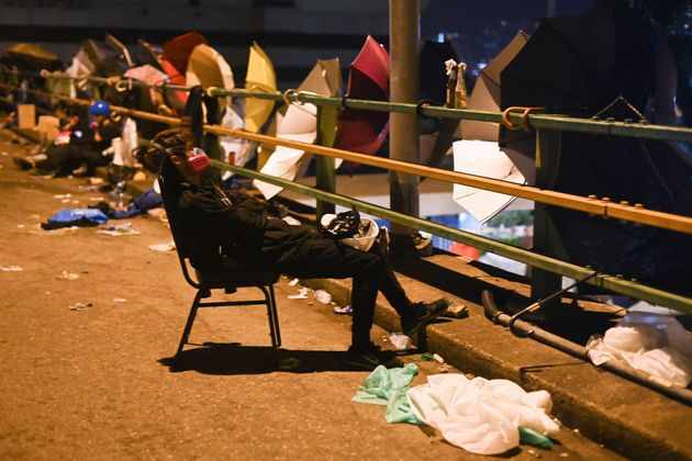 A protestor takes a rest outside the Polytechnic University of Hong Kong in Hung Hom district of Hong...