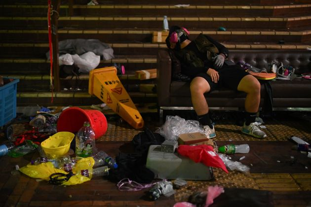 A protestor takes a rest inside the Polytechnic University of Hong Kong in Hung Hom district of Hong...