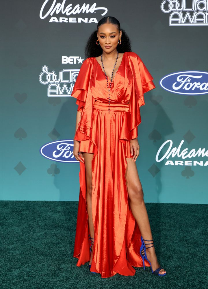 """Lyric Anderson of """"America's Next Top Model"""" is a vision of slinky glamor in her orange gown."""