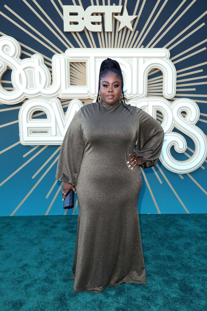 """Raven Goodwin from """"Being Mary Jane"""" and """"Good Luck Charlie"""" tantalized on the turquoise carpet in a glamorous gown."""