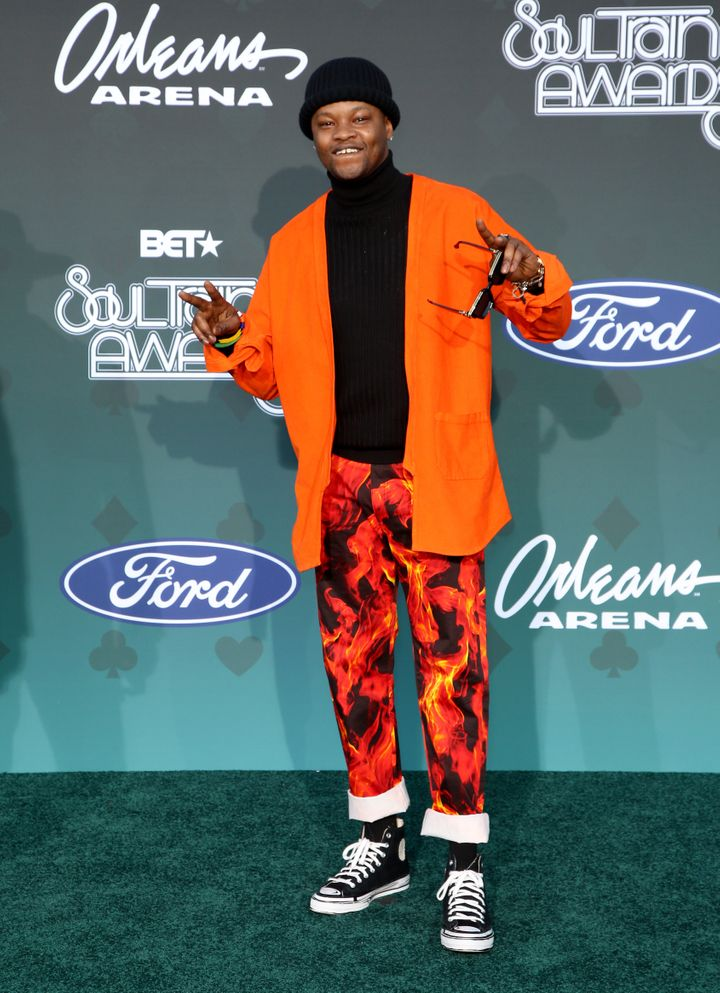 Multiple Grammy nominee BJ The Chicago Kid is orange poppin' in his fun ensemble.