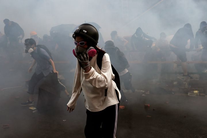 <strong>Protesters attempt to escape from tear gas while trying to leave the Polytechnic University campus on Monday</strong>