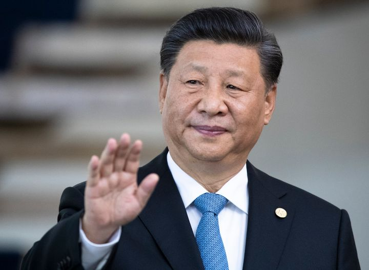China's President Xi Jinping greets the media prior to a meeting of leaders of the BRICS emerging economies at the Itamaraty palace in Brasilia, Brazil, Thursday, Nov. 14, 2019. (AP Photo/Pavel Golovkin, Pool)