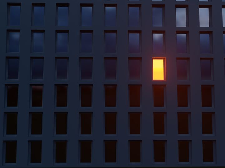 lonely luminous window in a dark house