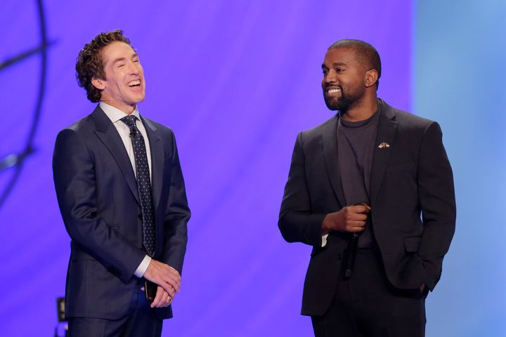 Kanye West, right, answers questions from senior pastor Joel Osteen, left, during a service at Lakewood Church, Sunday, Nov.