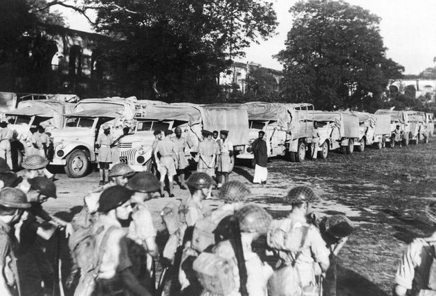 Army lorry convoys bearing food in famine-stricken Bengal, India, 1943. Then-PM Winston Churchill has...