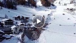 Neve e alberi si abbattono contro le case. Le riprese aeree della valanga