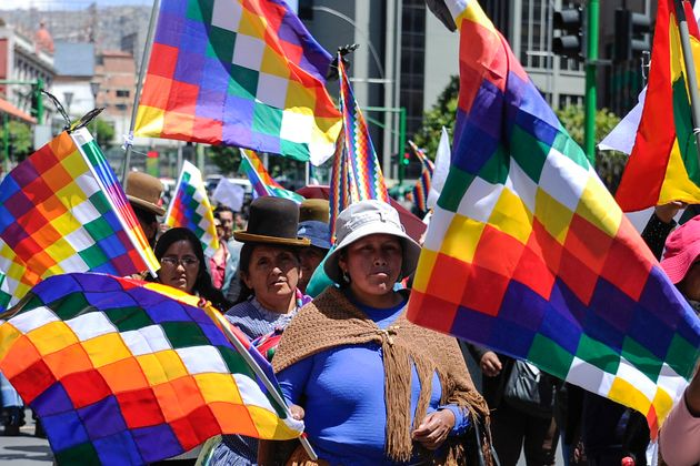 Supporters of Evo Morales carry Wiphala flags that represent Indigenous peoples in La Paz on Nov. 18,