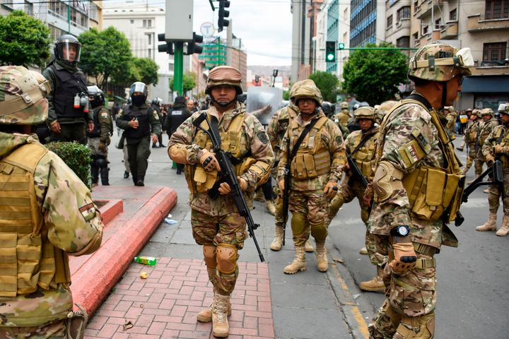 Militarized Bolivian police stand guard as supporters of Evo Morales demonstrate in La Paz on Nov.14, 2019.