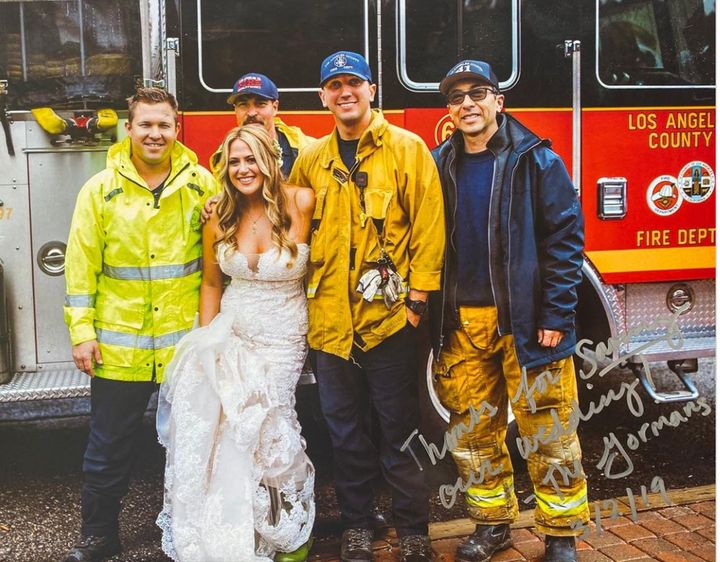 Firefighters gave this bride and her bridesmaids a ride to the wedding after their limo was stuck in traffic due to a car accident.