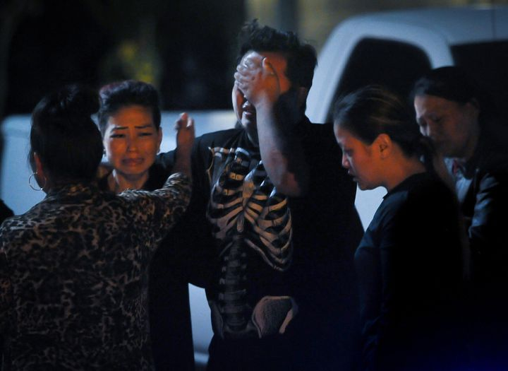 People are seen in the aftermath of a shooting Sunday evening in Fresno, California, that left four people dead.