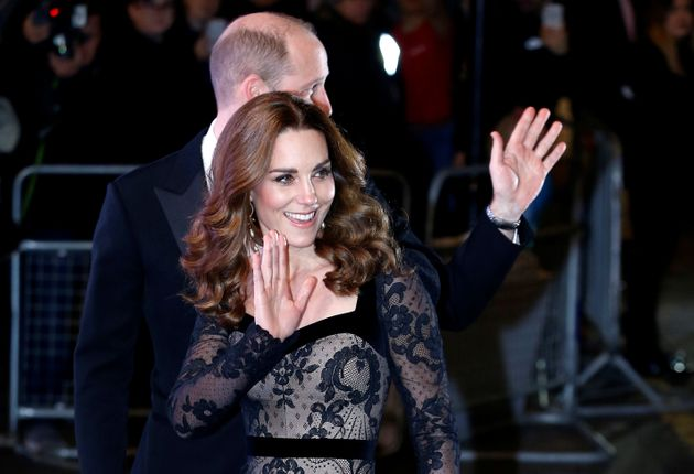 The royals are pictured waving to the crowds as they walked into the
