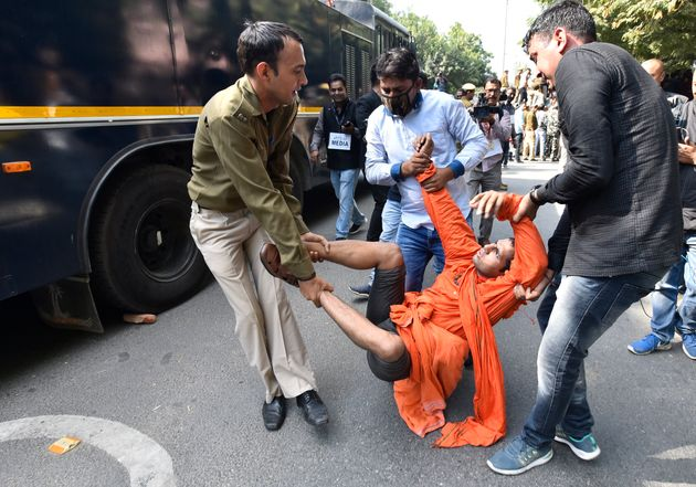 Police detain a student during a protest by the students of JNU against hostel fee hike, near JNU Campus...