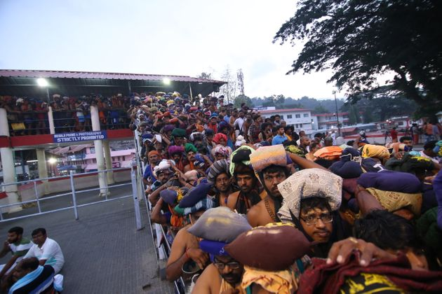 Devotees stand in line at the Sabarimala temple to pray at the