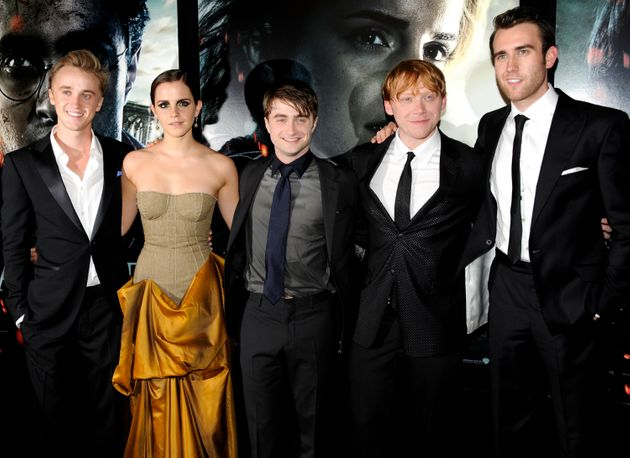 Tom Felton, Emma Watson, Daniel Radcliffe, Rupert Grint and Matthew Lewis pose together at the premiere...