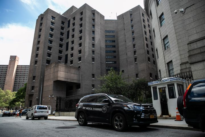 A medical examiner vehicle is seen outside the Metropolitan Correctional Center jail where financier Jeffrey Epstein was foun