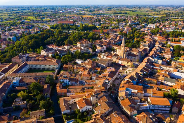 Picturesque aerial view of Portogruaro cityscape in sunny summer day,