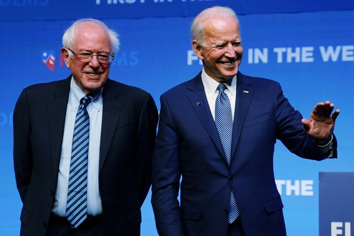 Sanders  and Joe Biden are pictured onstage at a First in the West Event at the Bellagio Hotel in Las Vegas, Nevada, on