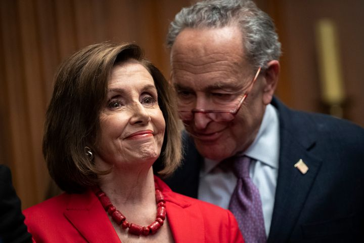 House Speaker Nancy Pelosi (D-Calif.) and Senate Minority Leader Chuck Schumer (D-N.Y.) speak with each other at a news confe