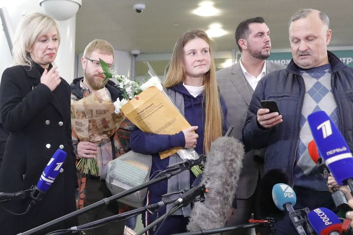 Russian citizen Maria Butina (center) is seen with her father Valery Butin (right) while talking to reporters in Russia follo