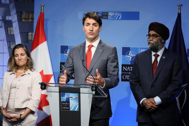 Justin Trudeau, Defence Minister Harjit Sajjan and Foreign Minister Chrystia Freeland after participating in the NATO Summit in Belgium on July 12, 2018.