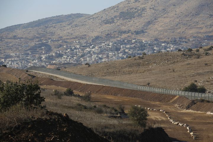 A picture taken on November 19, 2019 shows the Israeli fence separating the Israeli-occupied sector of the Golan Heights and
