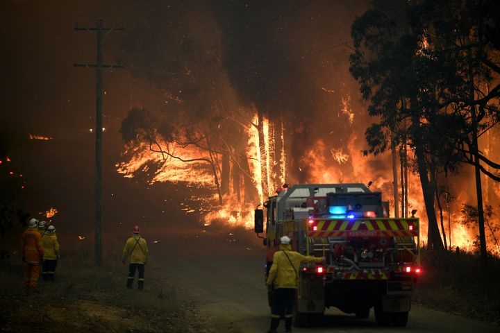NSW Rural Fire Service crews fight a fire as it burns close to property on Wheelbarrow Ridge Road at Colo Heights, north west of Sydney on November 19, 2019.