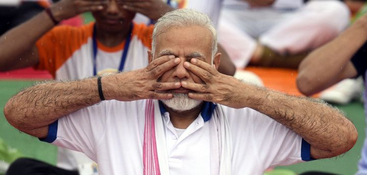 Prime Minister Narendra Modi along with thousands of people takes part in Yoga Session on International Day of Yoga at Ramabai Ambedkar Maidan on June 21, 2017 in Lucknow.