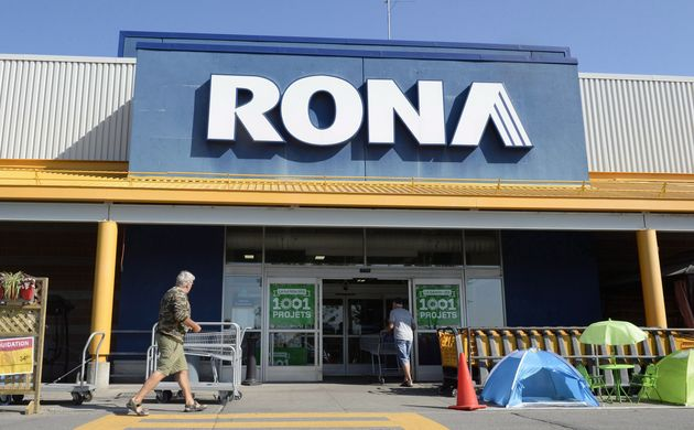 Customers enter a Rona home improvement store in St. Eustache, Que., Thurs. July 16,