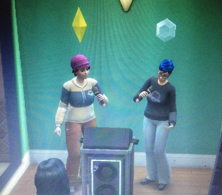 Sims version of Axi (left) and Ocean Capewell singing karaoke