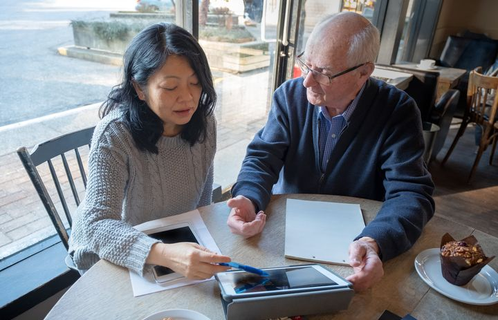 A financial expert helps an elderly man go over his personal finances in this stock photo. A survey suggests nearly half of Canadians are concerned about outliving their retirement savings.