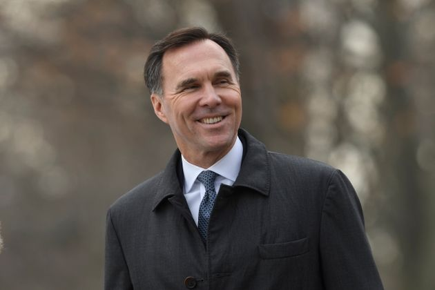 Liberal MP Bill Morneau arrives for the swearing-in ceremony in Ottawa on