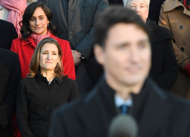 Liberal MPs Anita Anand, top left, and Chrystia Freeland look on as Prime Minister Justin Trudeau speaks...