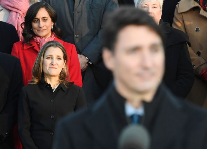 Liberal MPs Anita Anand, top left, and Chrystia Freeland look on as Prime Minister Justin Trudeau speaks following the swearing-in of the new cabinet at Rideau Hall in Ottawa on Nov. 20, 2019.