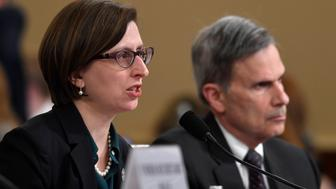 Deputy Assistant Secretary of Defense Laura Cooper, left, testifies before the House Intelligence Committee on Capitol Hill in Washington, Wednesday, Nov. 20, 2019, during a public impeachment hearing of President Donald Trump's efforts to tie U.S. aid for Ukraine to investigations of his political opponents. At right is her attorney Daniel Levin.(AP Photo/Susan Walsh)