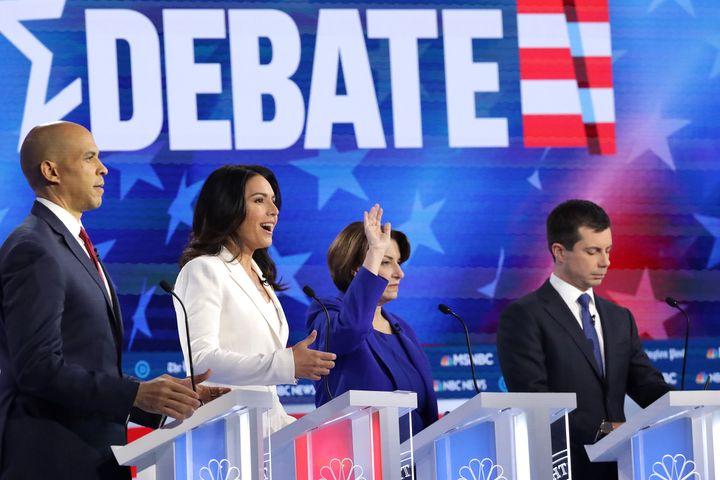 Democratic presidential candidates Sen. Cory Booker (D-N.J.), Rep. Tulsi Gabbard (D-Hawaii), Sen. Amy Klobuchar (D-Minn.) and