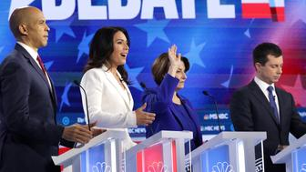 ATLANTA, GEORGIA - NOVEMBER 20: Democratic presidential candidate Sen. Cory Booker (D-NJ)  (L)  Rep. Tulsi Gabbard (D-HI), Sen. Amy Klobuchar (D-MN) and South Bend, Indiana Mayor Pete Buttigieg participate in the Democratic Presidential Debate at Tyler Perry Studios November 20, 2019 in Atlanta, Georgia. Ten Democratic presidential hopefuls were chosen from the larger field of candidates to participate in the debate hosted by MSNBC and The Washington Post.  (Photo by Alex Wong/Getty Images)